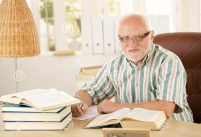older-man-working-his-study-16618114